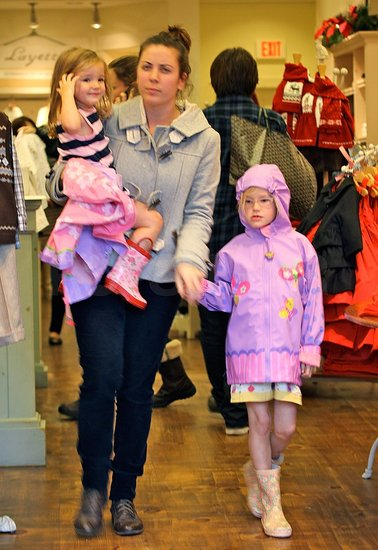 Seraphina and Violet held hands with their nanny inside a Janie and Jack store in LA.