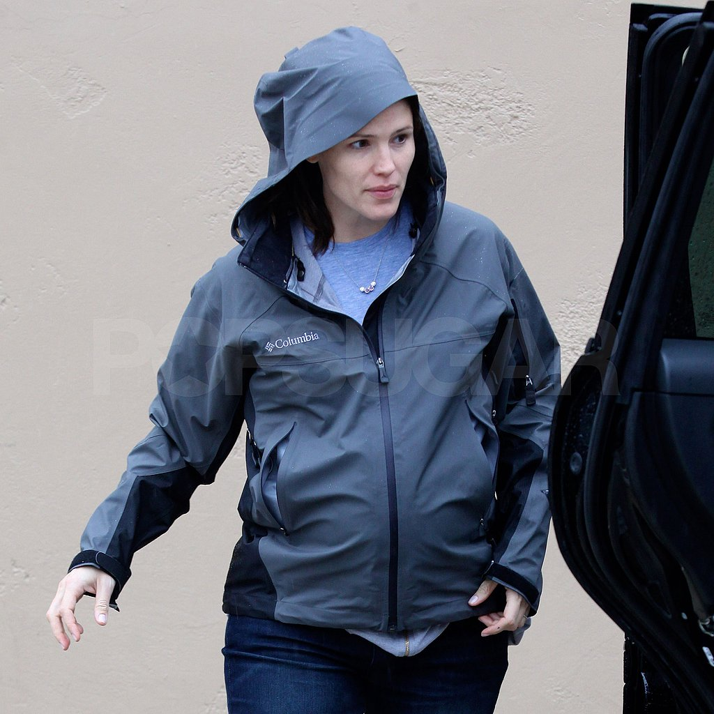 Jennifer Garner kept herself covered up to avoid the rain.