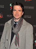 Matthew Settle topped his suit off with a scarf.