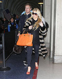 Pregnant Jessica Simpson at the airport with Eric Johnson.