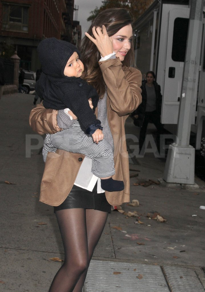 Miranda Kerr wrapped Flynn Bloom up in a hooded sweater.