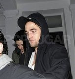 Robert Pattinson and Kristen Stewart headed out of their London home.