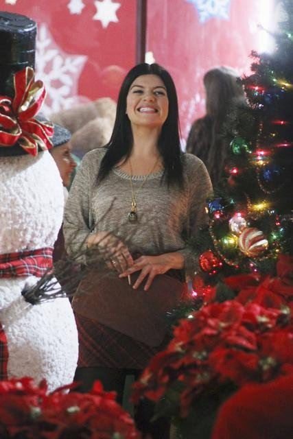 Penny is all smiles surrounded by a snowman and holiday cheer.  Photo copyright 2011 ABC, Inc.