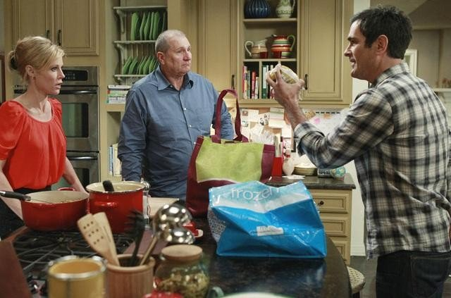Julie Bowen as Claire, Ed O'Neill as Jay, and Ty Burrell as Phil on Modern Family.  Photo copyright 2011 ABC, Inc.