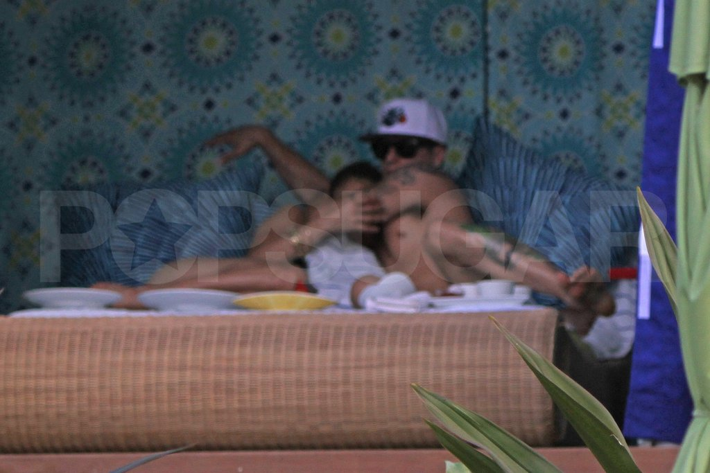 Jennifer Lopez and Caspar Smart cuddled in a Kauai cabana.