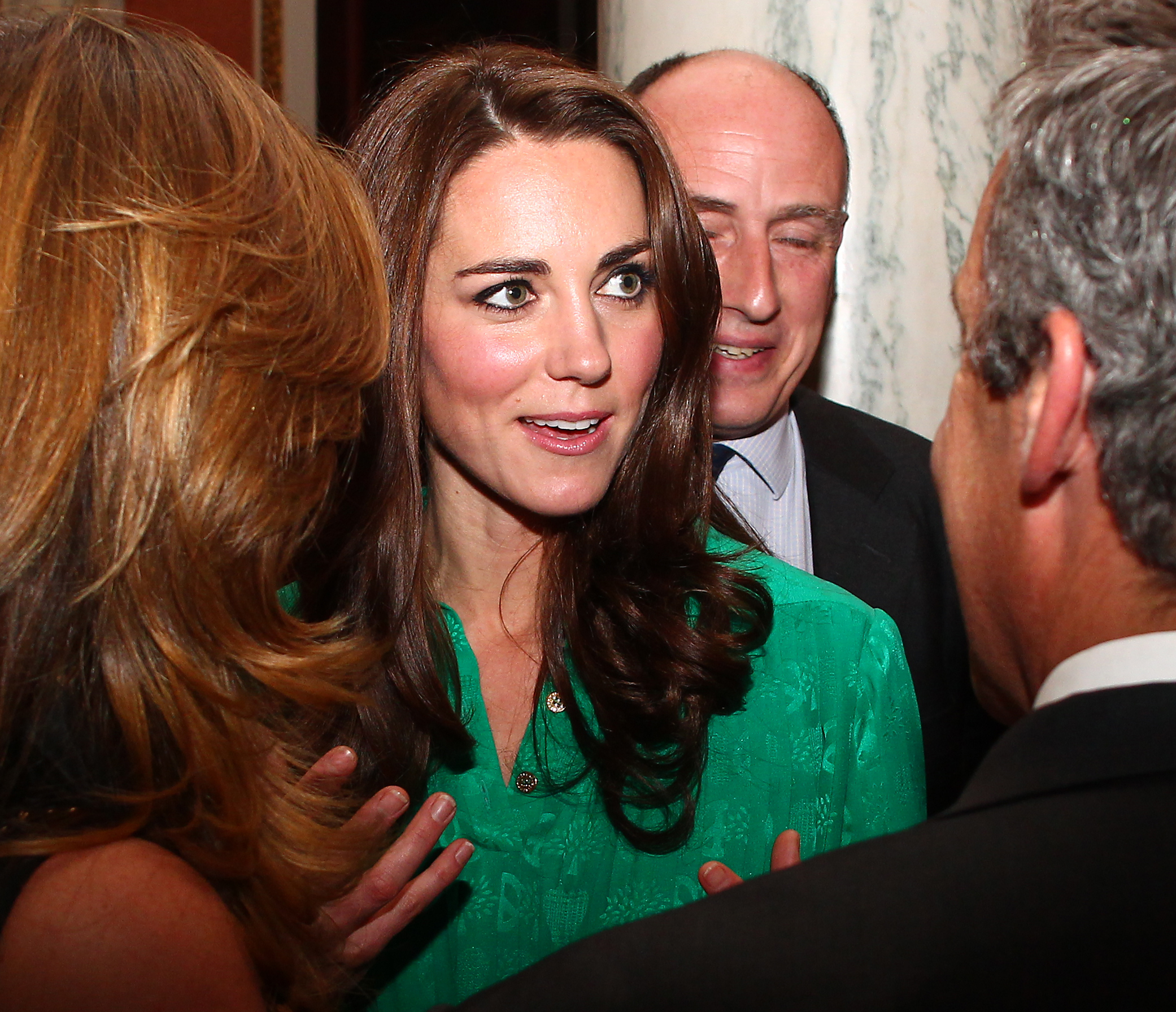 Kate Middleton wearing a green dress at a private reception.