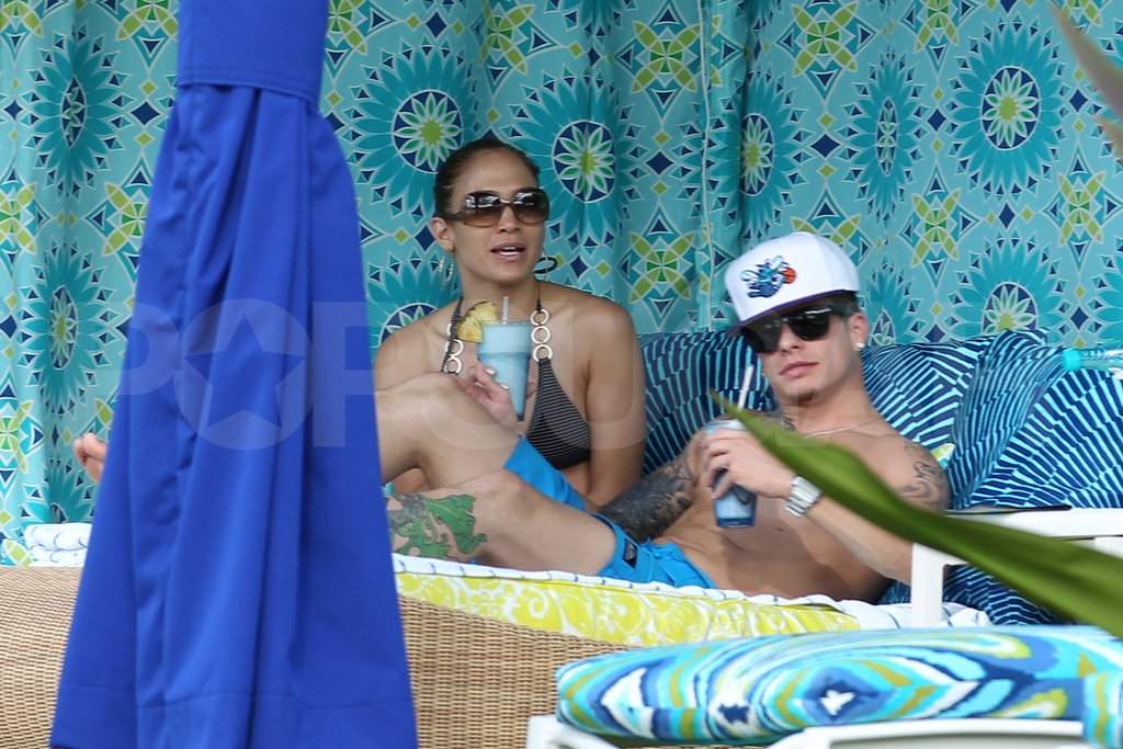 Jennifer Lopez wore a bikini to lounge with shirtless Caspar Smart.