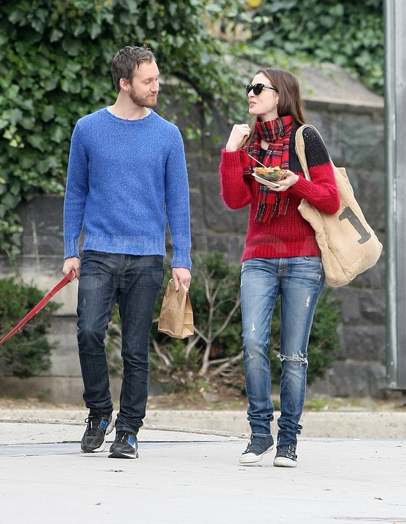 Anne Hathaway and Adam Shulman smiled lovingly at each other. She carried a FEED 1 Bag.