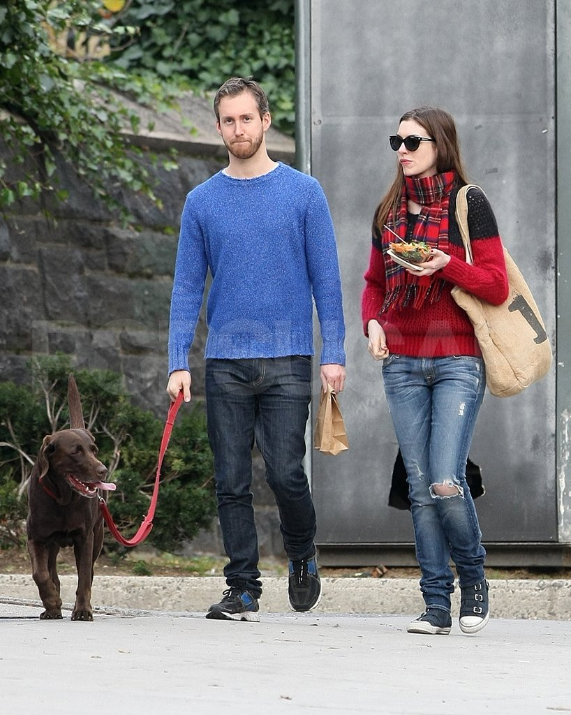 Anne Hathaway and Adam Shulman celebrated their engagement by walking their dog, Esmeralda.