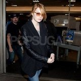 Emma Stone wore light brown sunglasses at LAX.
