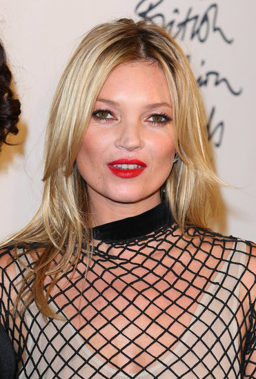 Kate Moss headed to the press room at the British Fashion Awards.