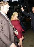 Eric Johnson helped Jessica Simpson navigate in the rain in NYC.