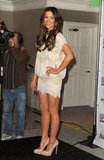 Kate Beckinsale showed off her tan legs in a short skirt.