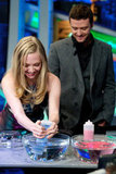 Amanda Seyfried squeezed blue dye into a bowl.