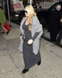 Jessica Simpson wore tall boots under her maxi dress.