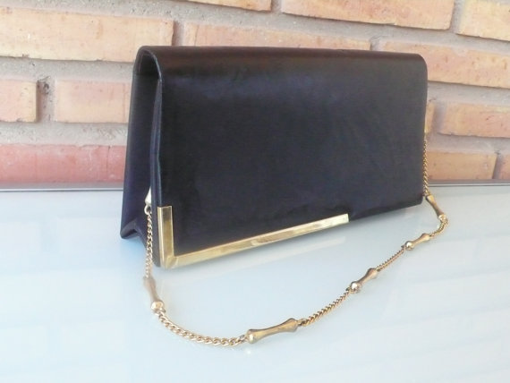 This bag manages to be both on-trend and still a unique find that not everyone else is toting around. Vintage Black Leather Cocktail Clutch ($35)