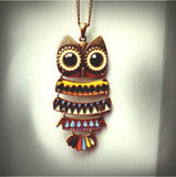 The rainbow-bright coloring makes this find perfect for the eclectic-bohemian type. Bohemian Owl Necklace ($18)