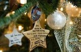 A decoration on the Gold Star Christmas tree shows fallen soldier SFC Carlos Santos-Silva.