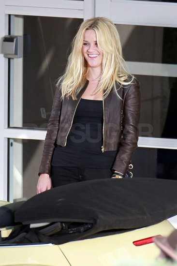 Reese Witherspoon flashed a smile between takes.