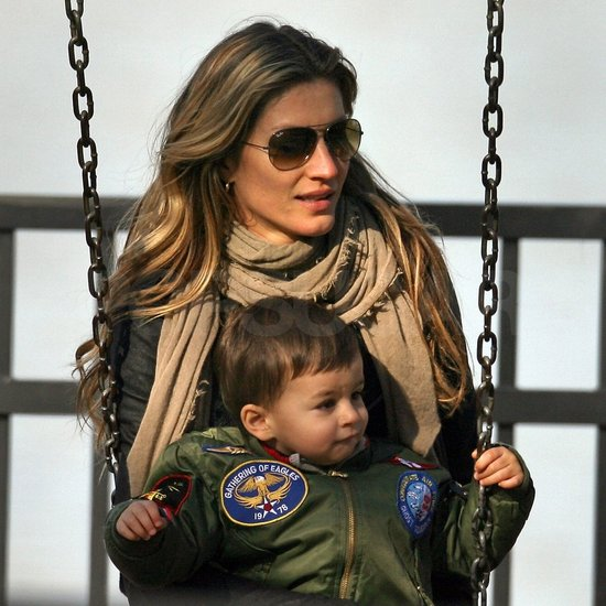 Gisele Bundchen and Ben Brady sat together on a swing.