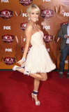 Carrie Underwood in a white dress at the American Country Awards in Las Vegas.