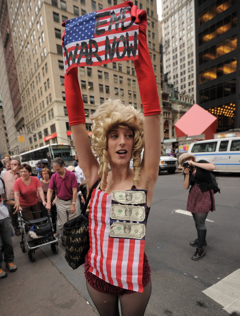 A woman protested the war during a march to the headquarters of the New York Police Department.