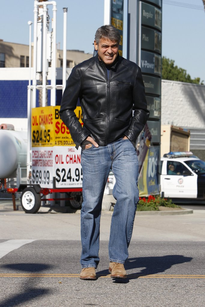 George Clooney bundled up in a leather jacket.