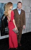 Jacqui Ainsley wore a red backless dress to see Sherlock Holmes: A Game of Shadows with Guy Ritchie.