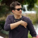 Orlando Bloom adjusted his shirt.