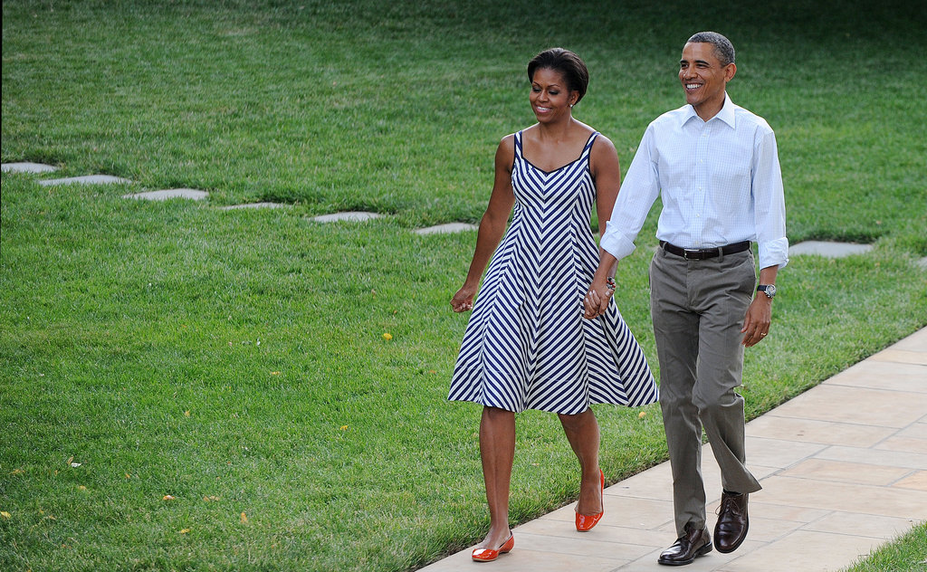 Michelle's practically skipping on her way to the Congressional Picnic at the White House in June.