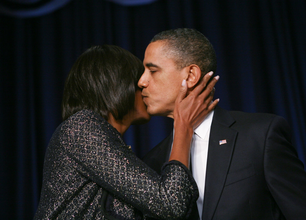 Michelle gives Barack an innocent kiss at the National Prayer Breakfast in February.