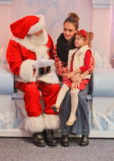 Jessica Alba and Honor visiting Santa Claus.