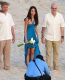 Selena Gomez held her dress up on the beach.