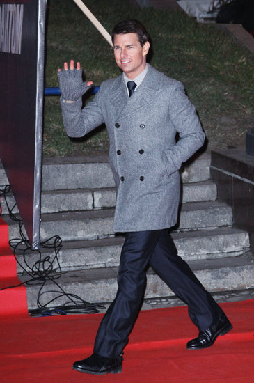 Tom Cruise headed into a Moscow premiere wearing fingerless gloves.