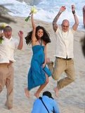 Selena Gomez jumped for the wedding photographer.