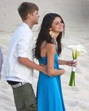 Justin Bieber put his arms around Selena Gomez.