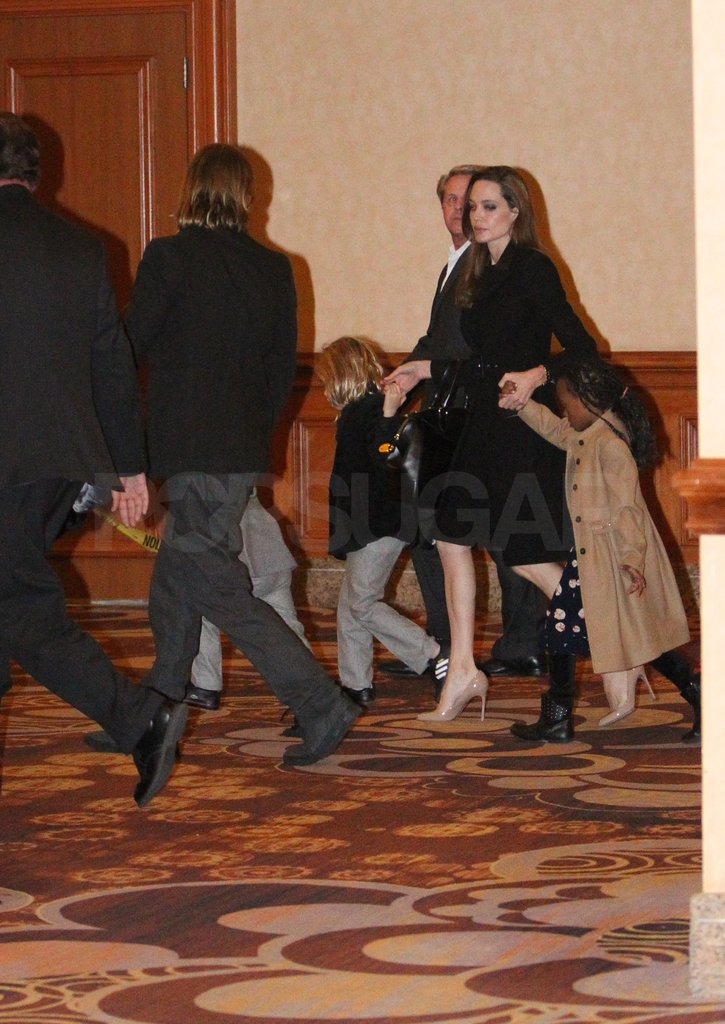 Angelina Jolie held hands with Shiloh and Zahara.