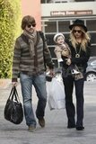 Rachel Zoe carried Skyler Berman, while Rodger Berman handled the bags.
