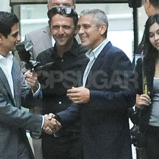 George Clooney stopped and said hello to photographers.
