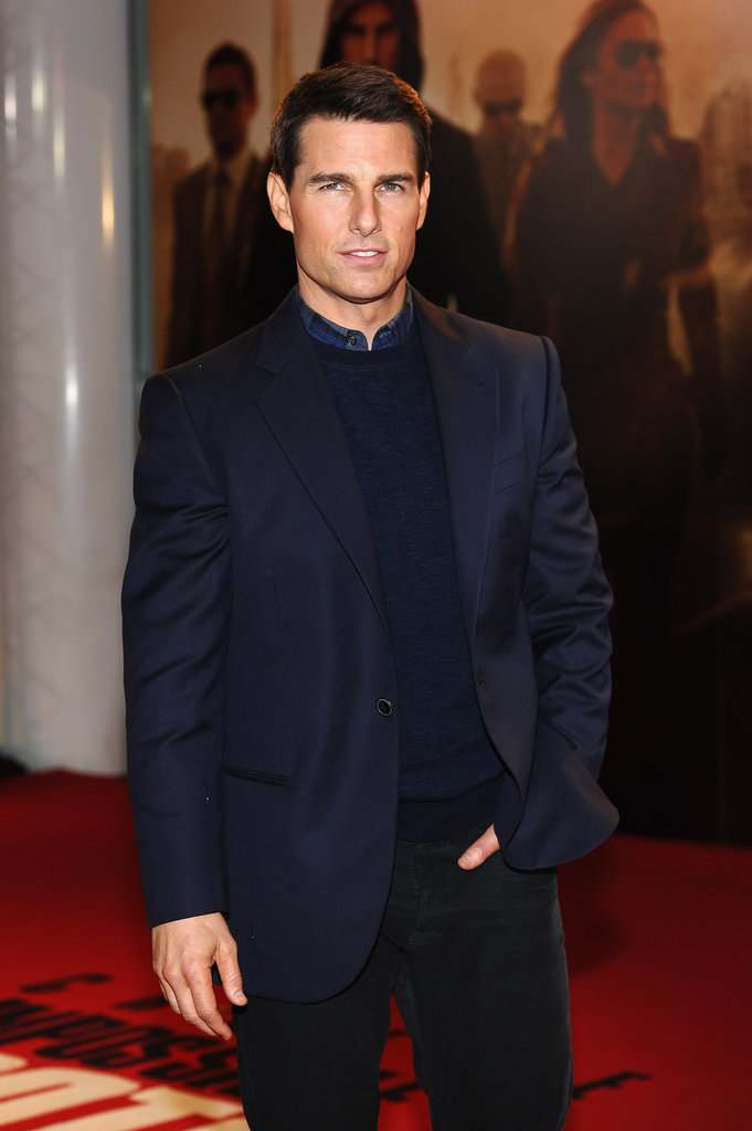 Tom Cruise looked handsome in a navy jacket and sweater.