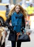 Blake Lively wearing a blue scarf.