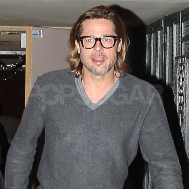 Brad Pitt wearing black glasses.