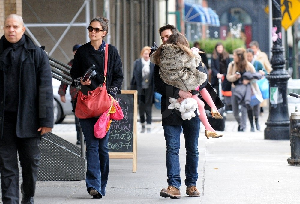 Katie Holmes carried a large red purse.