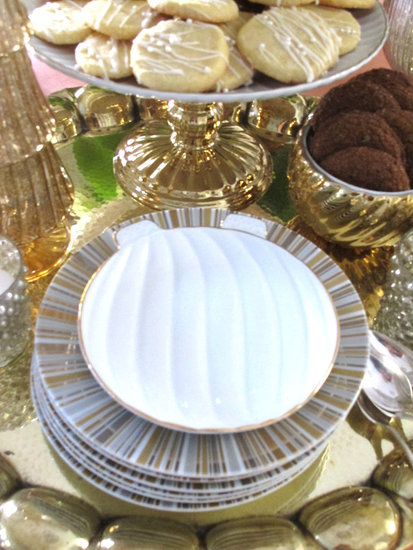 Darling, petite-sized Cindy Crawford ornament plates ($20 for four) add color and whimsy to any table.