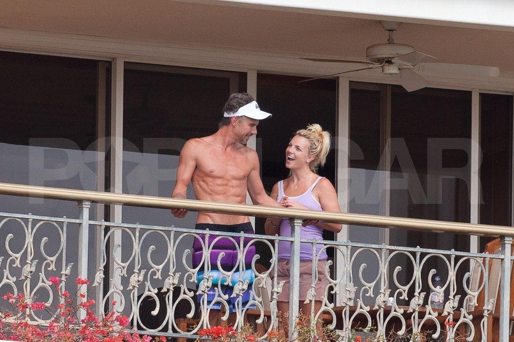 A shirtless Jason checked out the view from their balcony while on a Hawaiian vacation in August 2010.