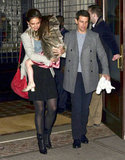 Katie Holmes carried Suri Cruise leaving NYC's Greenwich Hotel.