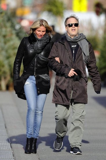 Cameron Diaz Keeps Warm and Cozies Up to a Mystery Man