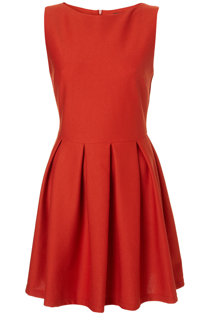 We love the bold, holiday hue and the fact that you could continually reinvent this dress just by changing up your accessories.  Topshop Structured Sleeveless Skater Dress (approx $71)