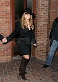 Mariah Carey in a black hat in Aspen.