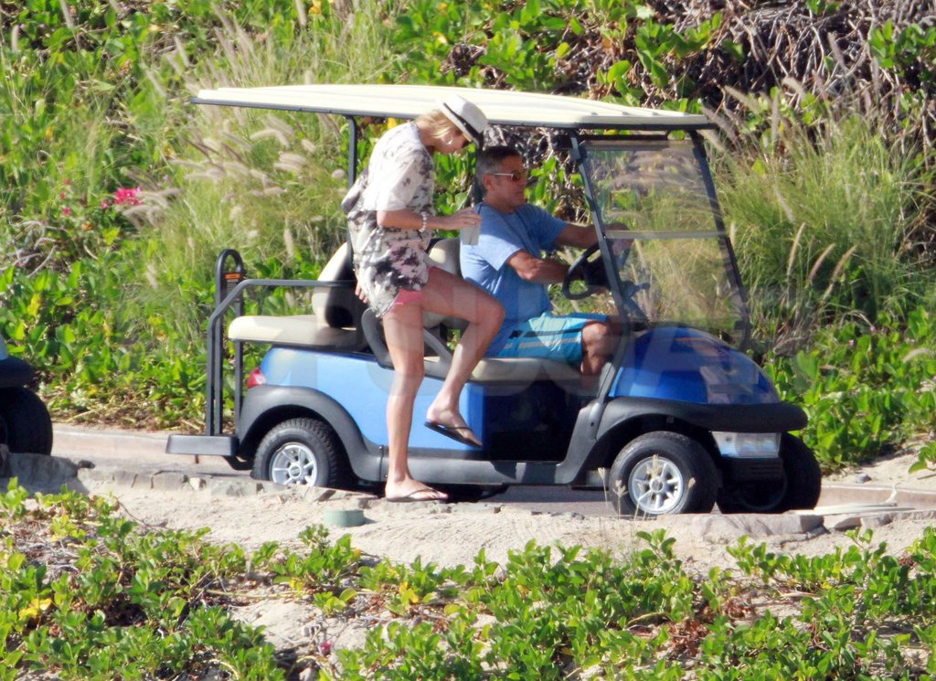 Stacy Keibler joined George Clooney in a golf cart.